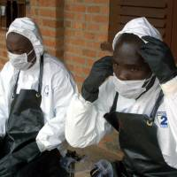 Medics suit up at Gabon's Mekambo hospital amid an Ebola outbreak in this file photo. Officials confirmed Thursday that the disease now sweeping Guinea has reached the capital, Conakry. | AFP-JIJI