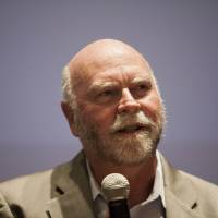 Craig Venter, who is creating a new firm to sequence 40,000 human genomes a year, addresses the forum Thursday.  | REUTERS