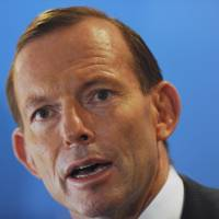 Abbott vows plane search will go on