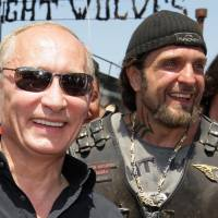Vladimir Putin and Alexander Zaldostanov, leader of a group of Russian bikers called the Night Wolves, in July 2010 meet Russian and Ukrainian motorcyclists camping near Sevastopol in Ukraine's Crimea region. | AFP-JIJI