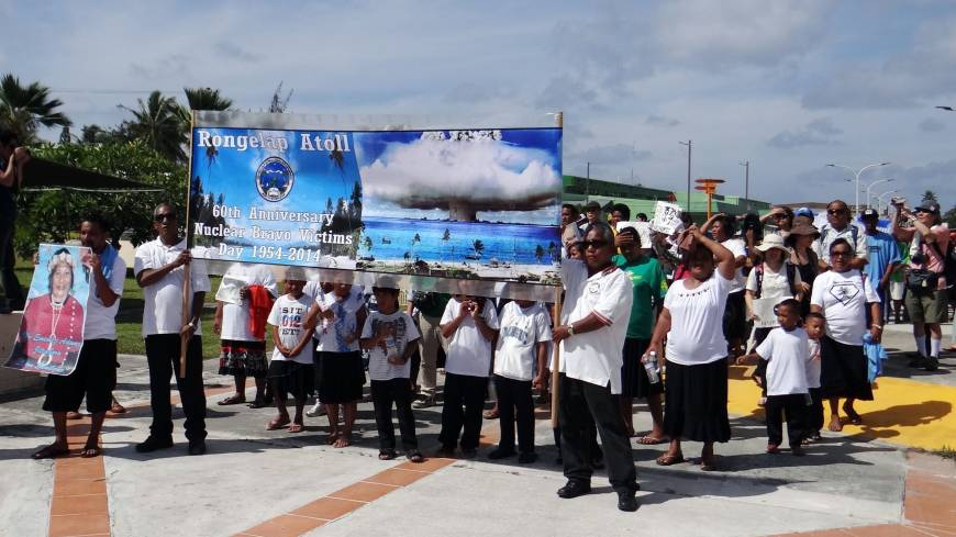 Islanders from Rongelap Atoll are seen in the Marshall Islands' capital, Majuro, on Saturday as they mark the 60th anniversary of the 1954 Bravo hydrogen bomb test at Bikini Atoll.