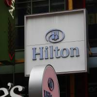 Hilton Hotel signs are displayed in New York in December. | BLOOMBERG