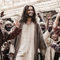 "This image released by 20th Century Fox shows Diogo Morgado (center) playing the role of Jesus Christ in a scene from the film ""Son of God.""   
