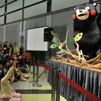 Kumamon, the popular bear mascot of Kumamoto, draws a big crowd to a campaign event promoting food products from the prefecture in Tokyo on Feb. 23. | AFP-JIJI