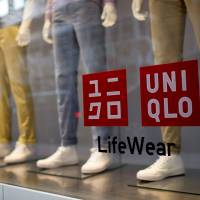 Mannequins advertise Uniqlo clothing at Fast Retailing Co.'s Lee Theatre flagship store in Hong Kong on Jan. 27. | BLOOMBERG