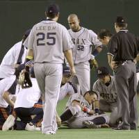 Buff luck: Tomotaka Sakaguchi's injury against the Giants last Thursday was typical of the Orix Buffaloes' bad fortune this season. | KYODO