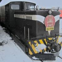 The stove train starting up from the terminal at Nakasato Station. The attached plow is used to clear snow from the tracks.