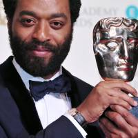 British actor Chiwetel Ejiofor poses with the award for a leading actor for his work on the film '12 Years a Slave' at the BAFTA British Academy Film Awards at the Royal Opera House in London on Feb. 16. | AFP-JIJI