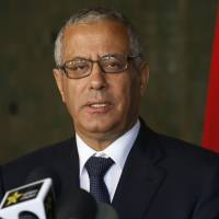 Libyan PM ousted after tanker escapes to sea with rebel oil