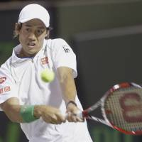 Special K: Kei Nishikori hits a return against Roger Federer during their quarterfinal match at the Sony Open on Wednesday in Key Biscayne, Florida. Nishikori won 3-6, 7-5, 6-4. | AP