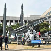 Visitors view North Korean Scud missile and South Korean Nike missile replicas at Seoul's Korean War Memorial Saturday. | AFP-JIJI