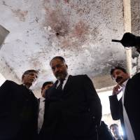 Justice Shaukat Aziz Siddiqui (center) of the Pakistani High Court visits a district court in Islamabad a day after a suicide attack by militants killed 11 people Monday. A spokesman for the Ahrar-ul-Hind militant group, which recently split from the main Tehreek-e-Taliban Pakistan umbrella group, claimed responsibility. | AFP-JIJI