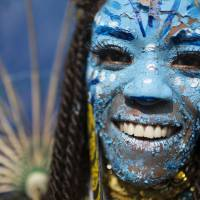 Rio revelers put protests on hold for Carnival