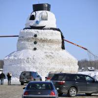 A giant 15-meter-tall snowman created by Greg Novak in Gilman, Minnesota, is seen Sunday. Novak built the massive snowman, named 'Granddaddy,' over the course of hundreds of hours. | AP