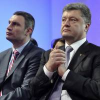 Ukrainian politicians Vitali Klitschko (left) and Petro Poroshenko attend a UDAR (Punch) party meeting in Kiev on Saturday. | REUTERS