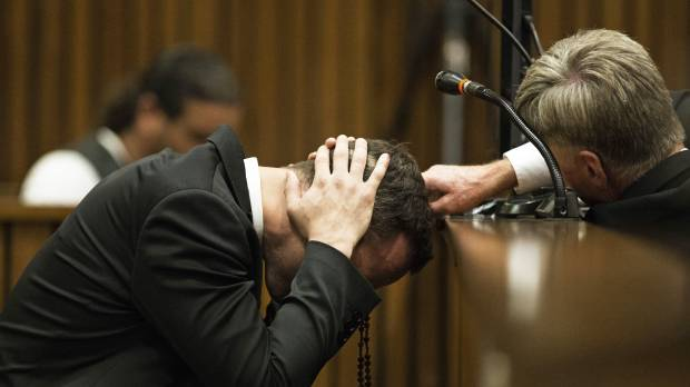 Witness says Pistorius prayed over his shot girlfriend