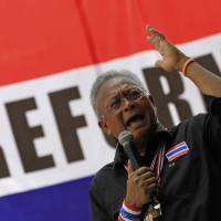 Thai anti-government protest leader Suthep Thaugsuban speaks to supporters in Bangkok on Friday. | AP
