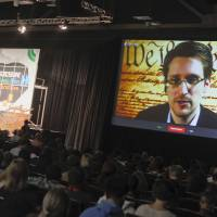 Snowden voices no regrets, says leaks sparked needed debate on spying
