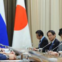 Russian President Vladimir Putin and Prime Minister Shinzo Abe meet in Sochi, Russia, on Feb. 8. | AP