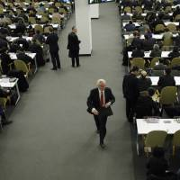 Russian Ambassador to the U.N. Vitaly Churkin (center) leaves the General Assembly after a resolution was approved on Ukraine's territorial integrity at U.N. headquarters in New York on Thursday. | REUTERS
