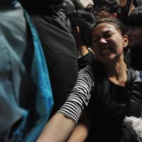 Taiwan police expel scores of protesters opposed to China trade pact