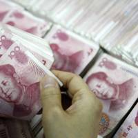 In move to aid economy, China widens yuan's fluctuation against dollar