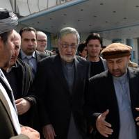 Rassoul boosted as Karzai's brother exits Afghan election