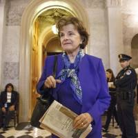 Sen. Dianne Feinstein, chairwoman of the Senate Intelligence Committee, leaves the chamber Tuesday after saying that the CIA's improper search of a computer network established for Congress has been referred to the Justice Department.   AP