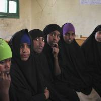 Teenage girls attend an after-school club that the U.N. children's agency UNICEF helps fund, one of whose subjects is discussion of the practice of female genital mutilation, at the Sheik Nuur Primary School in Hargeisa, Somaliland, on Sunday. | AP