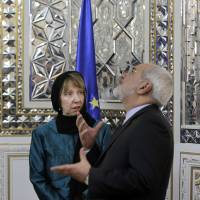 Iranian Foreign Minister Mohammad Javad Zarif (right) welcomes the European Union's foreign policy chief, Catherine Ashton, to a meeting in Tehran on Sunday. | AP
