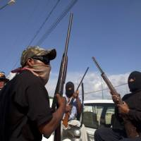 Mexico to crack down on vigilante 'self-defense' forces