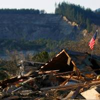 U.S. mudslide kills at least four, with 18 missing