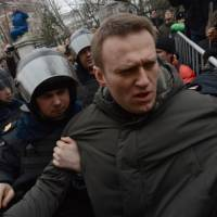 Russia puts anti-corruption crusader Navalny under house arrest