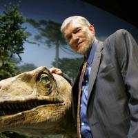 Ken Ham, founder of the nonprofit ministry Answers in Genesis, poses with one of his favorite animatronic dinosaurs during a tour of the Creation Museum in Petersburg, Kentucky, in May 2007. Ham, who recently debated evolution with TV's 'Science Guy' Bill Nye, says fundraising after the widely watched event helped to revive stalled plans to build a replica of Noah's Ark. | AP