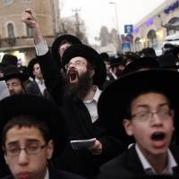 Ultra-Orthodox Jews rally against Israeli draft bill