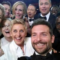 This cellphone selfie photo was taken during the Oscars at the Dolby Theatre in Los Angeles on Sunday and released by comedian and actress Ellen DeGeneres. Front, from left: Jared Leto (partly visible), Jennifer Lawrence, Meryl Streep, DeGeneres, Bradley Cooper and Peter Nyong'o Jr. Rear, from left: Channing Tatum, Julia Roberts, Kevin Spacey, Brad Pitt, Lupita Nyong'o and Angelina Jolie. | AP
