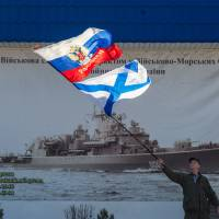 Putin orders end to military exercises; warning shots fired in Crimea