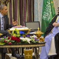 U.S. President Barack Obama meets with Saudi King Abdullah in Rawdat Khuraim, Saudi Arabia, on Friday. | AP