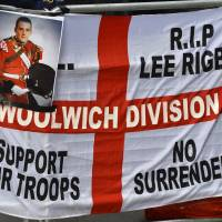 A banner and photographs of murdered British soldier Lee Rigby are displayed during a protest outside the Old Bailey courthouse in London on Feb. 26. | REUTERS