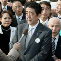 Prime Minister Shinzo Abe speaks to reporters Saturday during a visit to Tamura, Fukushima Prefecture, to check the progress of reconstruction efforts since the March 11, 2011, catastrophe. | POOL