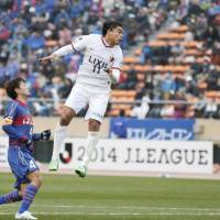 Double impact: Antlers' Davi scores on a second-half header against Ventforet on Saturday at National Stadium. Davi had two goals in Kashima's 4-0 win over Kofu. | KYODO