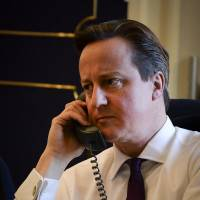 British Premier Cameron laughs off Twitter parodies of Obama call photo