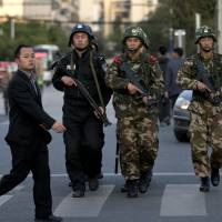 Knife gang tried to leave China before attack: report
