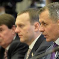 Crimea's Parliament speaker, Vladimir Konstantinov (right), attends a meeting at the Russian Parliament in Moscow on Friday, when the Russian legislature said it will abide by the 'historic choice' to be made by Crimea when the Ukrainian region's people vote in a referendum on joining Russia later this month. | AFP-JIJI