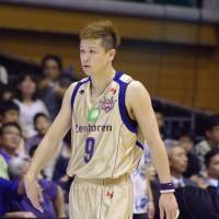 Extra work: Ryukyu guard Naoto Kosuge, seen in this file photo from last season, and his teammates needed overtime to defeat host Fukuoka 80-74 on Friday night. Kosuge scored seven points and collected four steals. | HANA SUZUKI