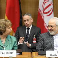 Russia, U.S. try to set aside Ukraine crisis for Iran nuclear talks