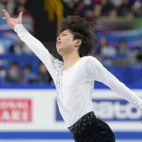 My time to shine: Tatsuki Machida skates during the men's competition at the figure skating world championships on Wednesday in Saitama. Machida is in first place after the short program. | KYODO