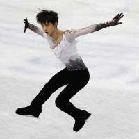 Storybook finish: Yuzuru Hanyu, competing in the free program on Friday night, lands eight triple jumps en route to a gold medal at the World Figure Skating Championships at Saitama Super Arena. | REUTERS
