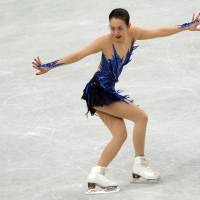 National icon: Mao Asada performs during the women's free skate on Saturday at the World Figure Skating Championships in Saitama. Mao earned her third world title. | AFP-JIJI