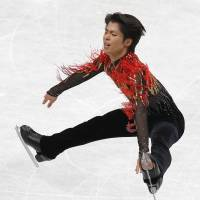 In-air artistry: Silver medalist Tatsuki Machida skates during the men's free program on Friday at Saitama Super Arena. | REUTERS